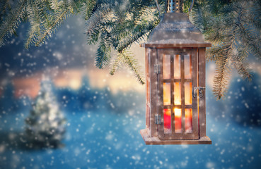 Christmas lantern hanging on fir branches