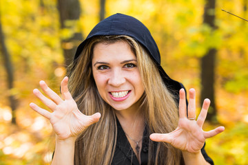 portrait of beautiful blond young woman holding pumpkin in