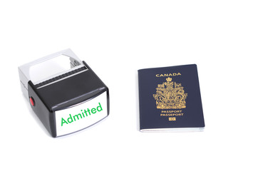 Canadian passport and admitted stamp on white background