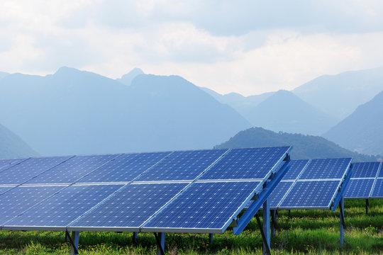 solar panels against mountains