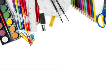 Whiteboard with school supplies top border / School supplies top border on a whiteboard background