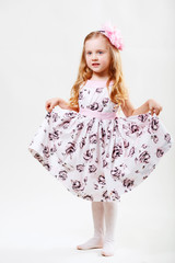 Full length portrait of a cute little dancing girl