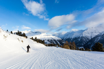 Male skier on easy ski piste