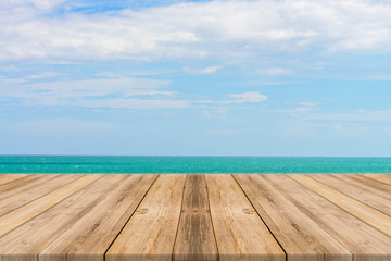 Vintage wooden board empty table in front of blue sea & sky background. Perspective wood floor over sea and sky - can be used for display or montage your products. beach & summer concepts.