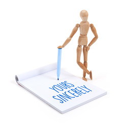 Wooden mannequin writing - Yours sincerely