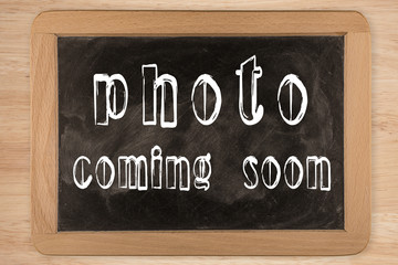 photo coming soon -  chalkboard with outlined text - on wood