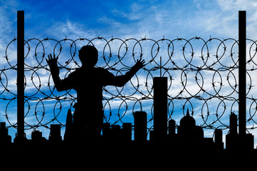 Silhouette refugee fence
