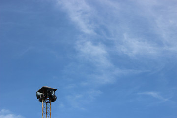 Loudspeaker for communication, info, publishing with blue sky background.