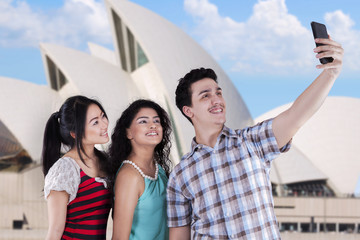Multiracial teenagers taking selfie in Sydney