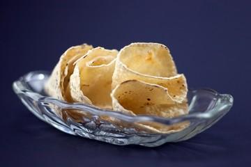 Indian Papadum crisps in a glass bowl