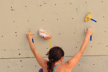 Girl climbing a rock wall