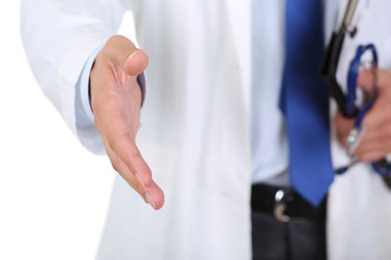 Male medicine doctor offering hand to shake