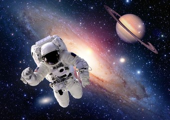 Astronaut spaceman suit outer space saturn planet people universe. Elements of this image furnished by NASA.
