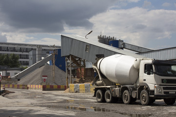 Cement Plant,Concrete or cement factory, white cement mixer in the foreground