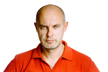 Unshaven fearsome middle-aged man in a red T-shirt. Studio. isol
