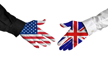United States and United Kingdom leaders shaking hands on a deal agreement