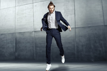 Attractive young man wearing sports suit