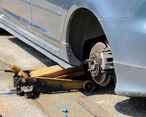 close up of car wheel tire replacement, car wheel hub, disc brak