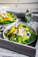 Green chicken salad on wooden background