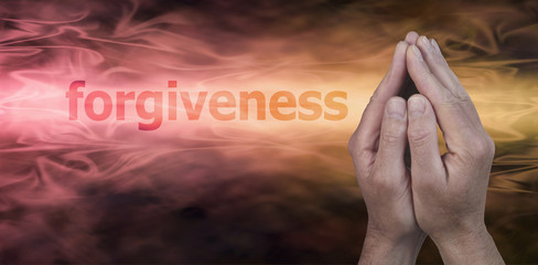 Seeking Forgiveness - Male hands in prayer position on a wide golden streaming background with the word Forgiveness to the left and plenty of copy space beneath