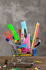 Stationery items in shopping trolley vertical