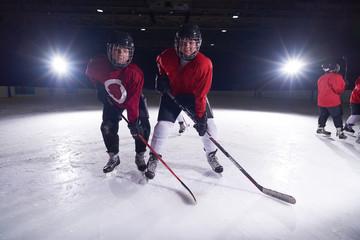 happy children gropu  hockey team sport players