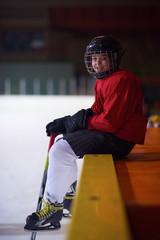 children ice hockey players on bench