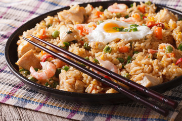 Indonesian cuisine: nasi goreng with chicken, shrimp and vegetables