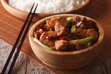 Kung pao chicken fillets in a bowl close up. Horizontal
