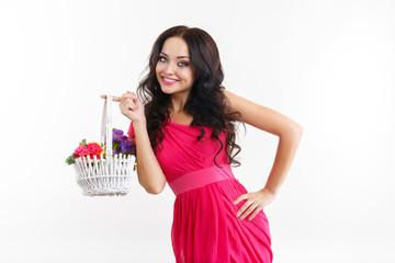 Beautiful girl wit basket of flowers