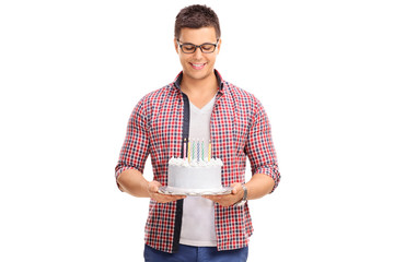 Joyful young man holding a birthday cake