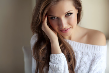 beautiful woman posing in a sweater