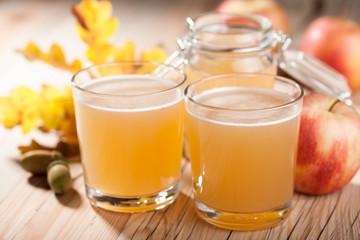 Fresh apple juice and apples