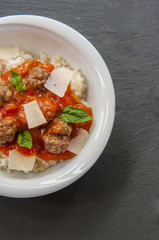 Delicious meatballs made from ground beef in a spicy tomato sauce