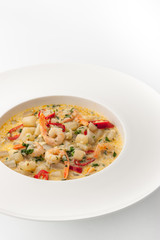 Saute with seafood on the white background vertical