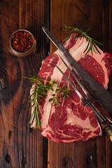 raw beef Ribeye  steak   on wooden  table