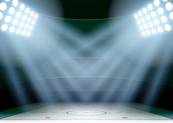 Background for posters night ice hockey stadium in the spotlight