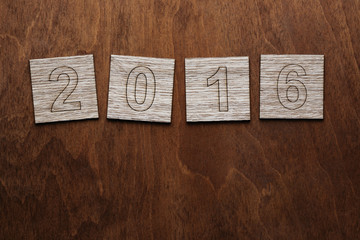Number 2016 on wooden background