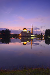 Reflection of a beautiful mosque during blue hour.