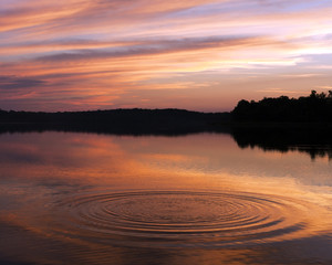 Ripples in a lake at sunset