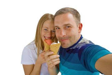 Young couple eating ice cream and making selfie photo