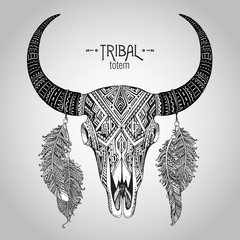 Hand drawn Vector illustration of bull skull with feathers.