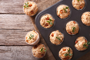 muffins with ham and cheese in baking dish. Horizontal top view