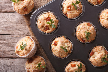 muffins with ham and cheese close up in baking dish. horizontal top view