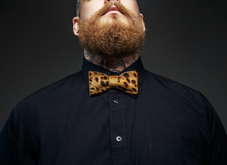 Part of man's face with red beard.