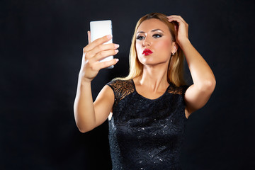 Blond fashion woman smartphone selfie
