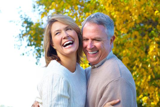 Happy senior couple in park.