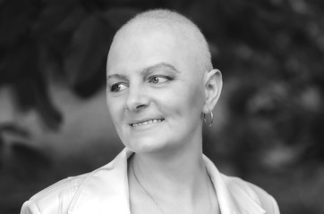 Portrait of breast cancer survivor woman with positive attitude.