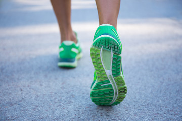 close up of female legs running on road