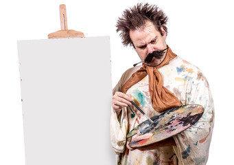 serious painter paints on canvas